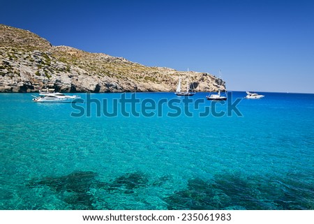 Blue water in Majorca. Cala Mondrago - stock photo