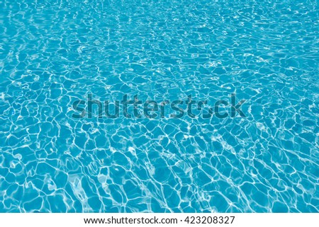 Blue water in swimming pool - stock photo