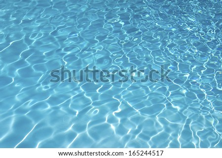 Blue water in the swimming pool - stock photo