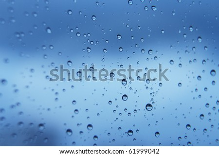 blue water soft bubbles on the window for background - stock photo