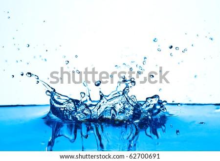 Blue water splashing isolated on white background. - stock photo
