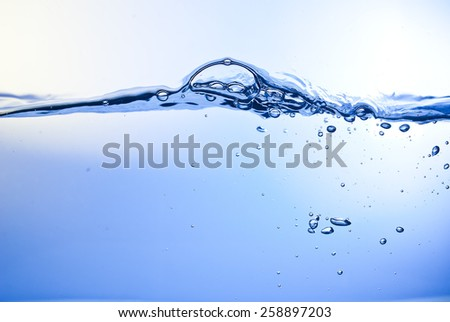 blue water wave and bubbles - stock photo