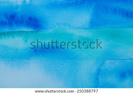 blue watercolors on textured paper - stock photo