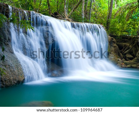 Blue waterfall in Kanjanaburi Thailand - stock photo