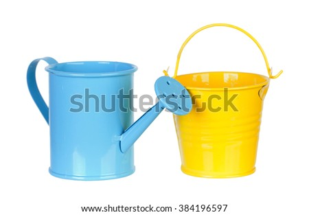 Blue watering can and yellow bucket on a white background - stock photo