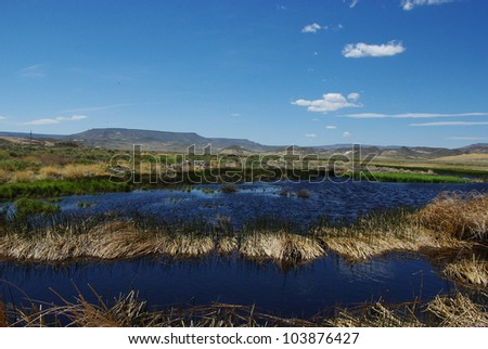 Blue waters in the desert, Sheldon National Wildlife Refuge, Nevada - stock photo