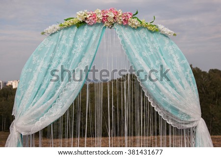 blue wedding arch, exit wedding registration, wedding arch on the background of nature - stock photo