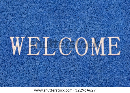 Blue welcome carpet background texture - stock photo