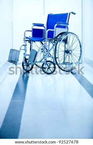 Blue wheelchair at the entrance of a hospital - stock photo