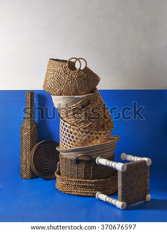 blue white wall wicker basket and stool - stock photo