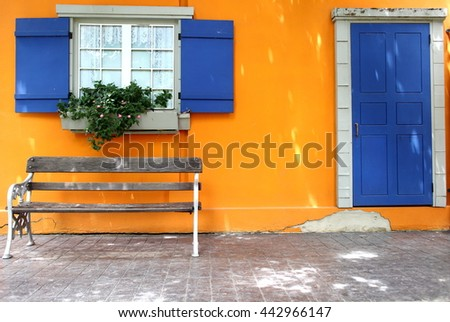 Blue Window and Door Floors, walls, orange, yellow Chairs are placed - stock photo