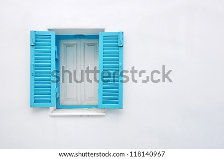 Blue window on white wall - stock photo