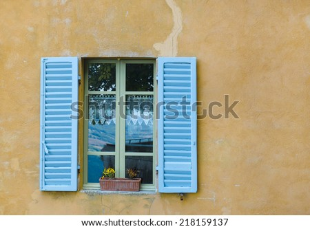 Blue window with shutters in old stone house, Italy - stock photo