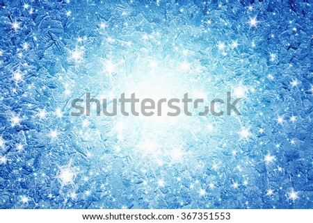 Blue winter background - frozen icy window glass, cold weather - stock photo
