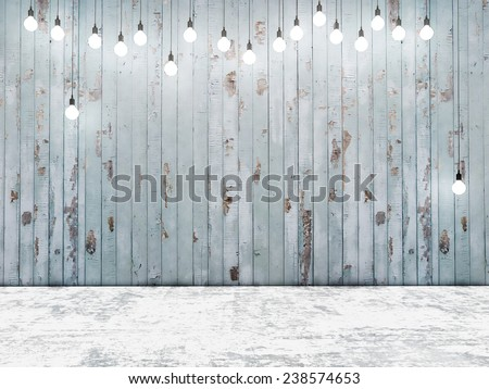 Blue wooden wall with light bulbs, background - stock photo