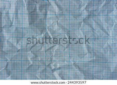 Blue wrinkled graph paper background - stock photo