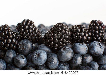 Blueberries and blackberries close-up. Healthy eating. - stock photo
