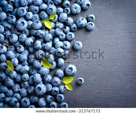 Blueberries background. Blueberry border design. Ripe and juicy fresh picked bilberries close up. Copyspace for your text - stock photo