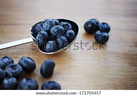 Blueberries in tablespoon - stock photo