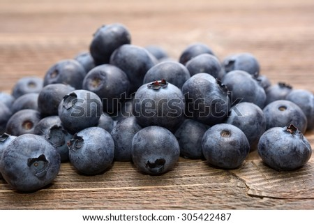 Blueberries on wooden table - stock photo