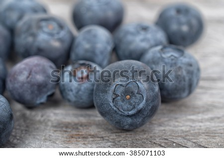 Blueberries on wooden table, selective focus - stock photo