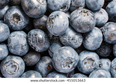 Blueberry background. Ripe and juicy fresh picked blueberries closeup. top view - stock photo