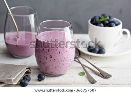 Blueberry banana pomegranate smoothie in a glass - stock photo