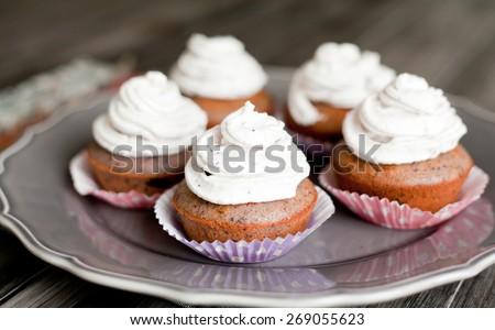 Blueberry cupcakes with butter cream. Homemade cakes. - stock photo