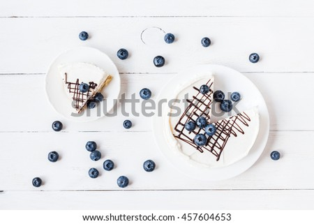 Blueberry dessert with white chocolate, cake. Top view, flat lay - stock photo