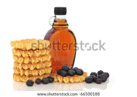 Blueberry fruit with waffles and maple syrup, isolated over white background. - stock photo