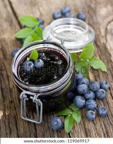 Blueberry jam in a preserving glass - stock photo