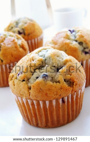 blueberry muffins with coffee cup and maker - stock photo
