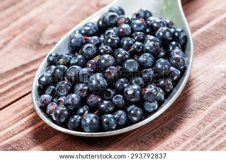 Blueberry on a old wooden table. - stock photo
