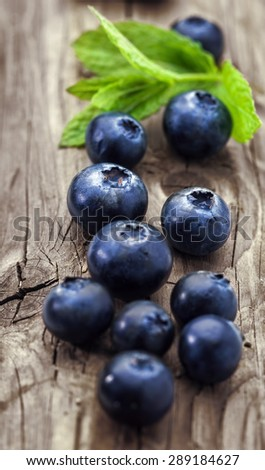Blueberry on a wooden background,vertical, close-up - stock photo