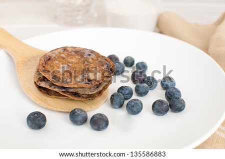 Blueberry pancakes from healthy oats and whole wheat - stock photo