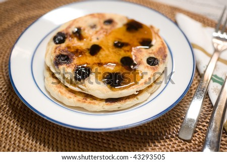 Blueberry pancakes with maple syrup ready to eat - stock photo