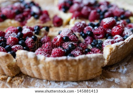 blueberry pie with raspberries, food close up - stock photo