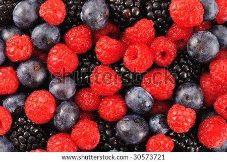 Blueberry, raspberry and blackberry patterned background material. - stock photo