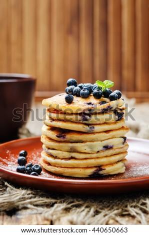 Blueberry Ricotta Pancakes on a dark wood background. toning. selective focus - stock photo