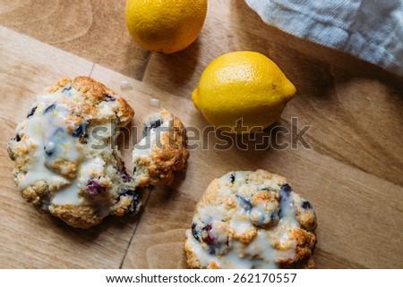 Blueberry Scones with Lemon Glaze on a Wood Background - stock photo