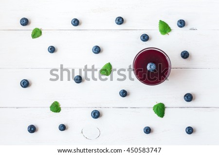 Blueberry smoothie on wooden white background. Healthy food, breakfast. Top view, flat lay  - stock photo