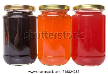 Blueberry, strawberry and orange fruit bottled jam over white background - stock photo