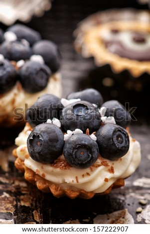 Blueberry tart with whipped cream, mascarpone cheese and chocolate - stock photo
