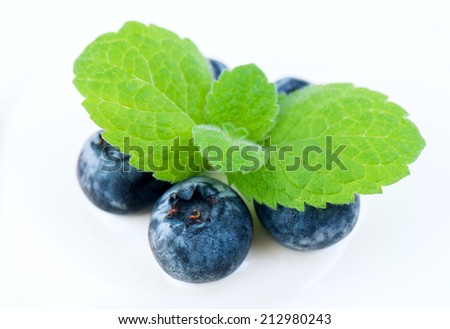 blueberry with mint leaves on a white pie - stock photo