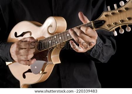 bluegrass musician playing a mandolin - stock photo