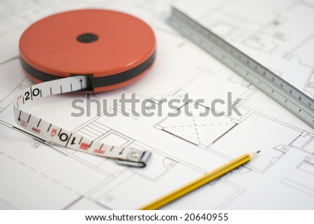 Blueprint of house plans and tools - stock photo