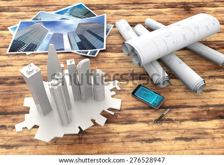 blueprints and 3d model on wooden table - stock photo