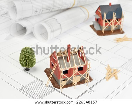 Blueprints and house structure - stock photo