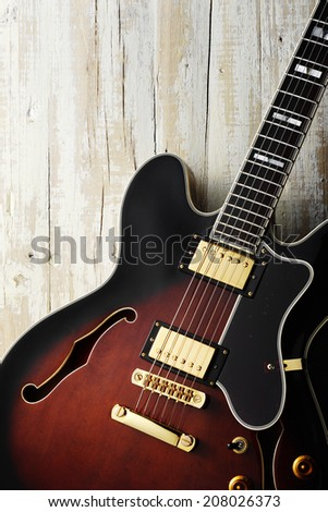 blues electric blues guitar on aged white wood - stock photo