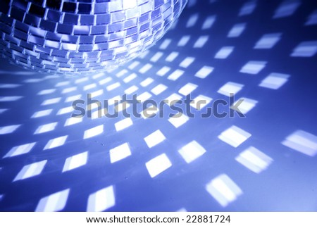 bluetoned closeup of disco ball and its reflections - stock photo